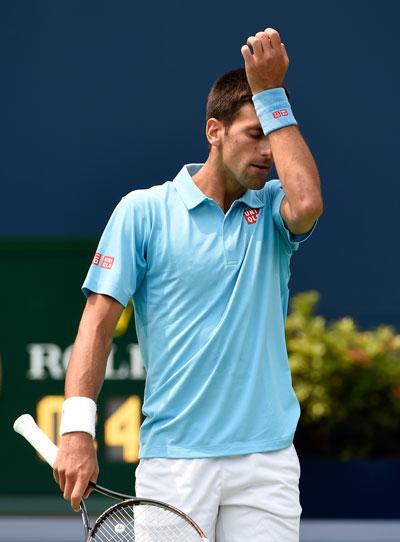 Djokovic thất vọng với chính mình khi thua chóng vánh Tsonga chỉ sau 63 phút Ảnh: REUTERS