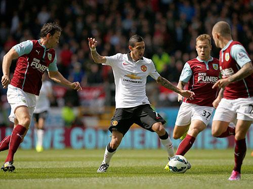 Di Maria (áo trắng) không thể vượt qua hàng thủ kiên cường của Burnley Ảnh: REUTERS