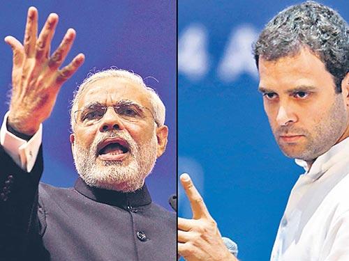 Hai ông Narendra Modi (trái) và Rahul Gandhi  Ảnh: HINDUSTAN TIMES
