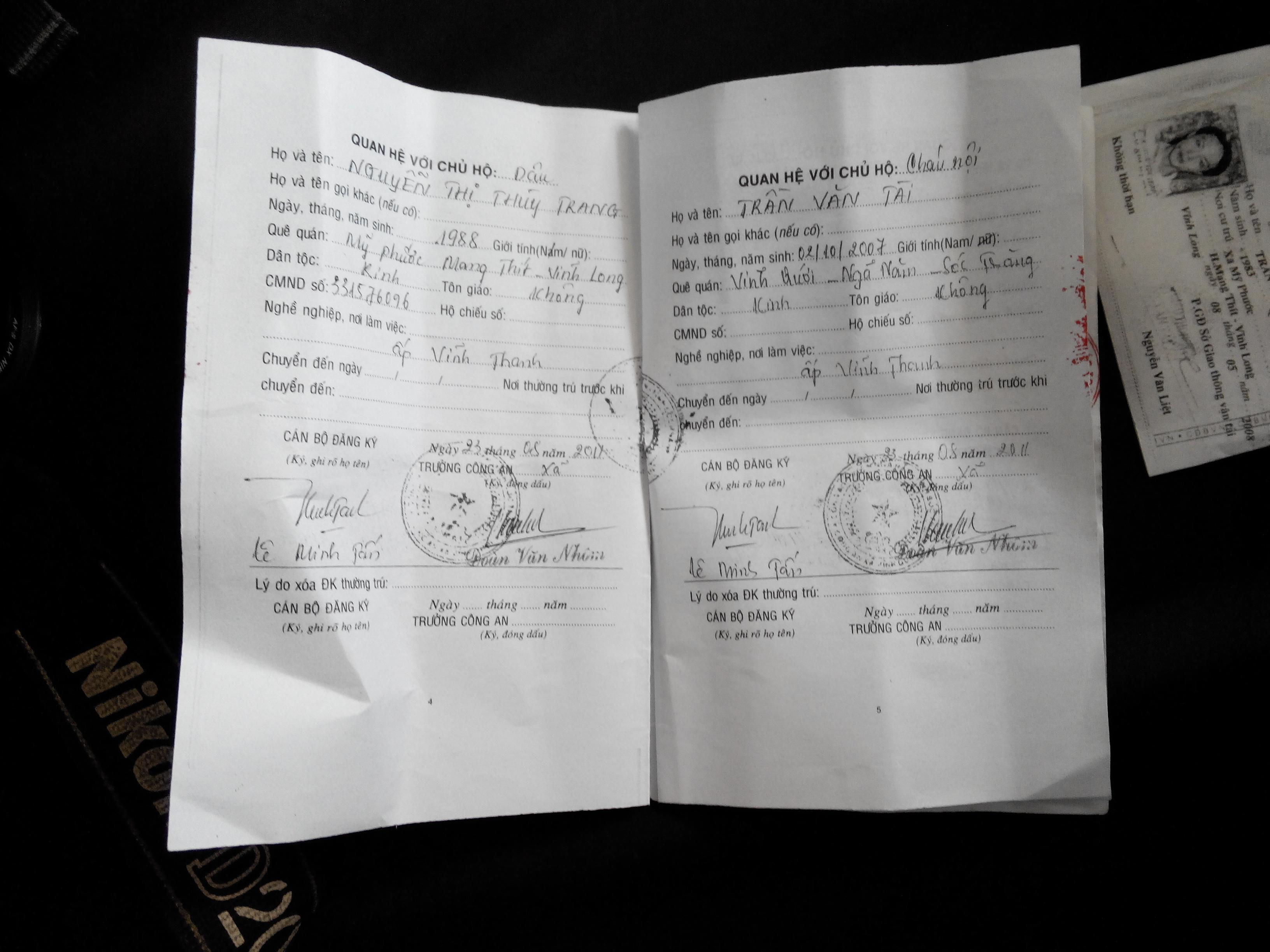 Sổ hộ khẩu gia đình có tên Trần Thị Thùy Trang
