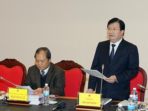 Bộ trưởng Bộ Xây dựng Trịnh Đình Dũng phát biểu tại phiên họp Ảnh: TTXVN