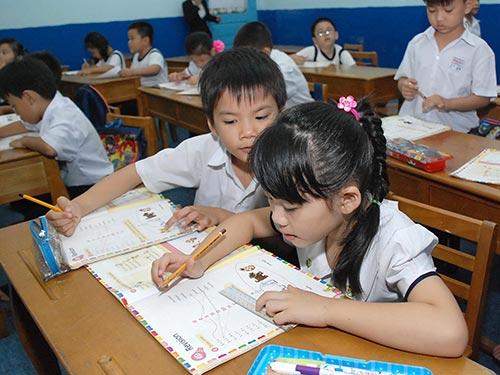 Học sinh Trường Minh Đạo (quận 5, TP HCM) trong giờ học tiếng Anh theo chương trình Cambridge Ảnh: TẤN THẠNH/NLĐO