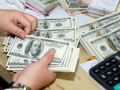 Điều chỉnh tỉ giá VNĐ/USD ở mức hợp lý và đúng thời điểm sẽ có lợi nhiều mặt cho nền kinh tế  Ảnh: TẤN THẠNH