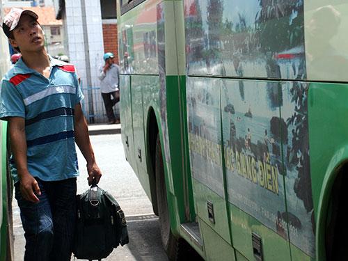 Xe buýt sẽ thân thiện hơn khi có quảng cáo ở thân xe với những hình ảnh đẹp mắt  Ảnh: TẤN THẠNH