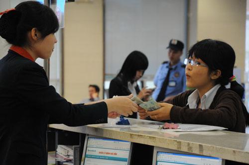 Cần phân bổ tăng trưởng tín dụng đều trong năm để tránh tăng lạm phát Ảnh: HỒNG THÚY