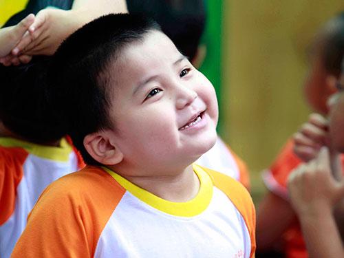 Nụ cười hồn nhiên của học sinh Trường Giáo dục chuyên biệt Khai Trí, TP HCM Ảnh: HOÀNG TRIỀU