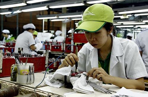 Khi Cộng đồng Kinh tế ASEAN chính thức đi vào hoạt động sẽ tạo thêm điều kiện cho doanh nghiệp Việt  phát triển Ảnh: Hồng ThÚY