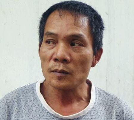 Người cha ác thú Đỗ Văn Lợi lúc mới bị bắt sau khi cùng người tình đánh chết con trai