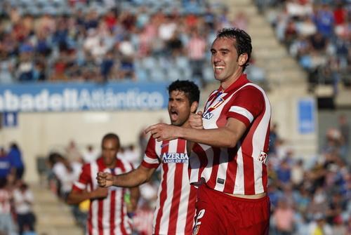 Diego Godin vui mừng với bàn thắng mở tỉ số