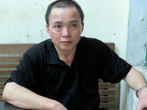 Nguyễn Thanh Sơn sau khi bị bắt tại cơ quan công an