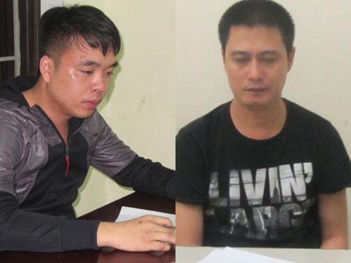Đối tượng Nguyễn Xuân Nam (phải) và đối tượng Hoàng Văn Mạnh tại cơ quan công an. Ảnh Long Quang.