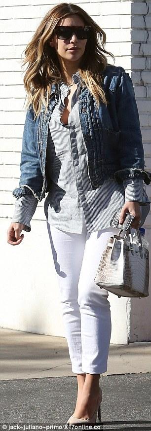 Kanye West bị tố đấm vào mặt kẻ văng tục với Kim Kardashian