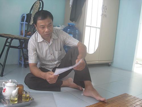 Ông Vũ cho rằng vì cách tính của phường sai nên ông không được hưởng BHYT cho hộ cận nghèo