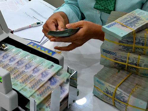 Thông tư 36 được kỳ vọng sẽ xử lý dứt điểm tình trạng sở hữu chéo trong ngân hàng. Ảnh: TẤN THẠNH