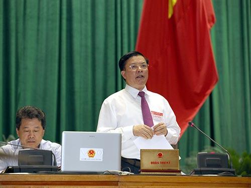 Bộ trưởng Đinh Tiến Dũng trả lời chất vấn trước Quốc hội Ảnh: long thắng