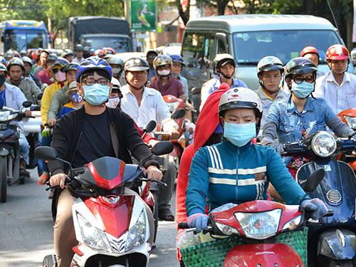 Từ ngày 9-1-2015, TP HCM sẽ thu phí xe máy Ảnh: TẤN THẠNH