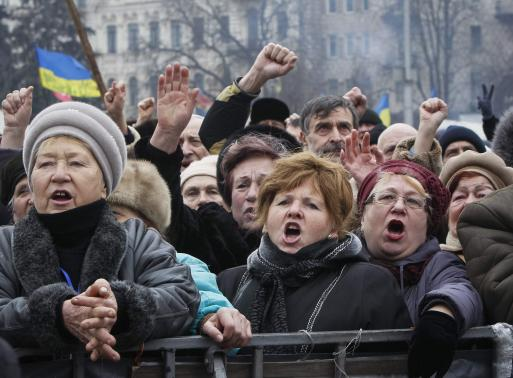 People shout slogans during an anti-government rally in Kiev February 9, 2014. REUTERS-Gleb Garanich