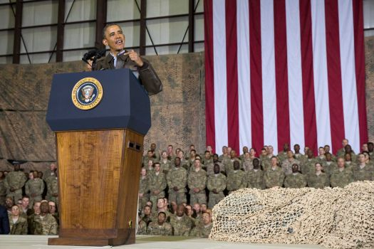 FILE - This May 25, 2014 file photo shows President Barack Obama speaking during a troop rally after arriving at Bagram Air Field for an unannounced visit, north of Kabul, Afghanistan. Senior U.S. administration officials say President Barack Obama will seek to keep 9,800 U.S. troops in Afghanistan after the war formally ends later this year. Nearly all of those forces are to be out by the end of 2016, as Obama finishes his second term. Photo: Evan Vucci, AP / AP