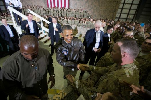 President Barack Obama shakes hands at a troop rally at Bagram Air Field, north of Kabul, Afghanistan, during an unannounced visit, on Sunday, May 25, 2014. Photo: Evan Vucci, AP / AP