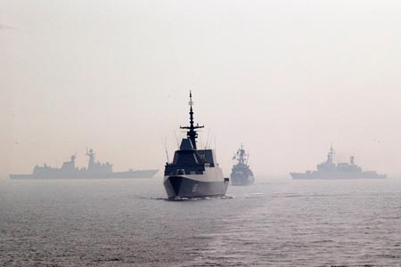 Peoples Liberation Army vessels take part in a naval exercise in the South China Sea, April 23. (Photo/CNS)