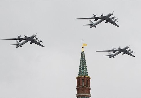 Russian Air Force Tu-95 bombers fly in formation over Red Square / AP