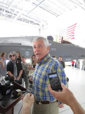 Defense Secretary Chuck Hagel stands in front of an F-35 joint strike fighter as he talks to reporters inside a hangar at Eglin Air Force Base in Florida.