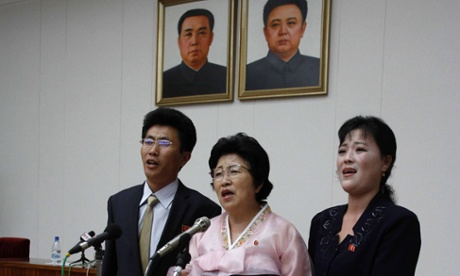North Korean defector Pak Jong-suk, centre, with her son and daughter-in-law after returning to North Korea. She is used as an example of a defector who was forgiven.