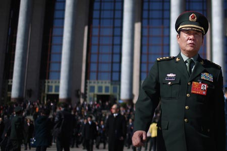 Liu Yuan leaves the Great Hall of the People during last years meeting of the National Peoples Congress, March 4, 2013. (Photo/CFP)