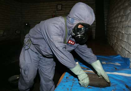An expert from the Office of the Ministry of Foreign Affairs for Chemical Weapons Abandoned by Japan in China, Huang Shunxiang, digs out a bomb at an excavation site of World War Two chemical weapons abandoned by Japan, in Ningan, Chinas Heilongjiang province, July 5, 2006. The two countries disagree on the scale of corroding weapons left behind by Japans army after the World War, with China saying there are 2 million shells to be dealt with, while Japan puts the figure in the hundreds of thousands. REUTERS