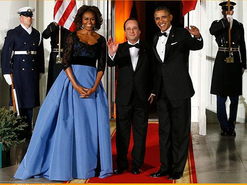 Tổng thống Mỹ Barack Obama (phải) và đệ nhất phu nhân Michelle Obama chào đón  Tổng thống Pháp Francois Hollande tại Nhà Trắng trước quốc yến. Ảnh:Reuters