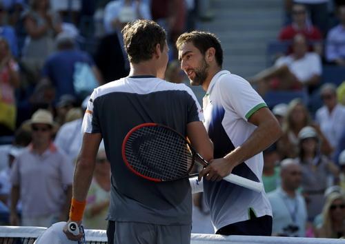 Cilic (phải) lần thứ nhì dự bán kết một giải Grand Slam