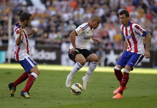 Atletico Madrid (áo đỏ) sẽ gặp đối thủ khó chịu Espanyol