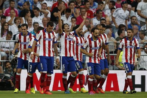 Tiago (5) mở tỉ số trận đấu từ rất sớm cho Atletico