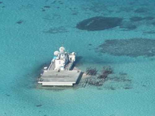Cơ sở Trung Quốc xây dựng trên bãi đá ngầm Gạc Ma Ảnh: AP