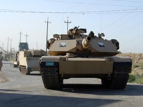 Quân đội Iraq đã gặp phải sức kháng cự dữ dội khi tấn công vào TP Tikrit hôm 28-6Ảnh: REUTERS
