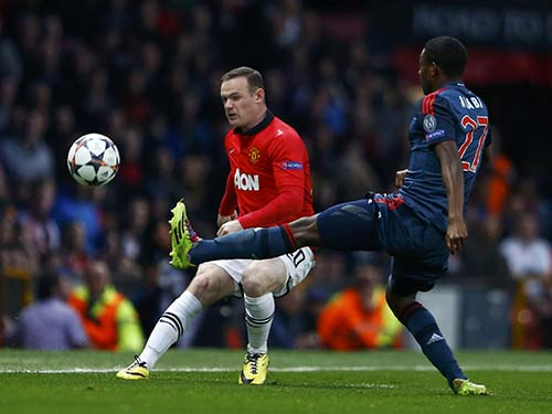 Rooney (trái) sẽ trở lại đội hình chính với quyết tâm cùng M.U lật đổ nhà vô địch Bayern ngay tại Đức Ảnh: REUTERS