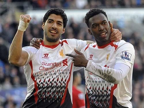 Cặp tiền đạo Suarez (trái) và Sturridge đã ghi tổng cộng 47 bàn ở giải ngoại hạng mùa này Ảnh: REUTERS