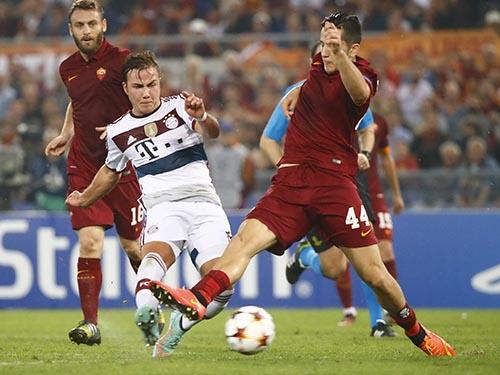 AS Roma (áo sậm) khó cản Bayern MunichẢnh: REUTERS