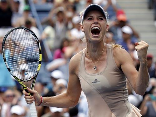 Wozniacki thi đấu dẻo dai dưới thời tiết nóng nhờ đang tích cực tập luyện để tham dự sự kiện marathon New York Ảnh: REUTERS
