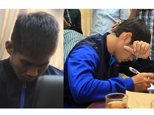 Long Giang (trái) và Thế Sơn viết tường trình tại trụ sở cơ quan điều tra.Ảnh: Hải Anh