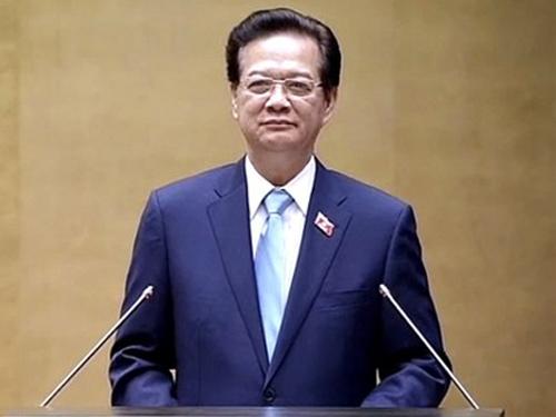 Thủ tướng Nguyễn Tấn Dũng trình bay báo cáo về tình hình kinh tế-xã hội năm 2014 và nhiệm vụ năm 2015 - Ảnh: VGP