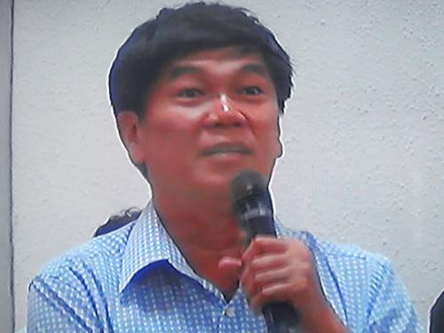 Ông Trần Đình Long đối chất tại phiên tòa - Ảnh chụp qua màn hình