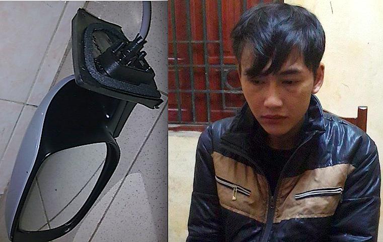 Ngô Thành Văn cùng chiếc gương ô tô vừa bị bẻ trộm sau khi bị bắt giữ