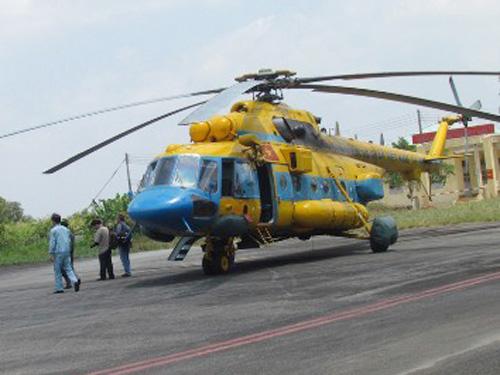 Máy bay trực thăng MI 171 của Việt Nam trước lúc cất cánh khỏi sân bay Cà Mau ngàyđi tìm kiếm chiếc máy bay MH 370 bị mất tích Malaysia mất tích