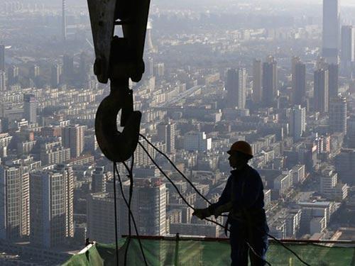 Trong quý III, kinh tế Trung Quốc tăng 7,3% so với cùng kỳ năm ngoái Ảnh: REUTERS
