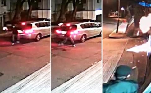 Kẻ phá hoại ném chai vào trước cửa nhà ông Lai. Hình ảnh lấy từ camera giám sát. Ảnh: SCMP
