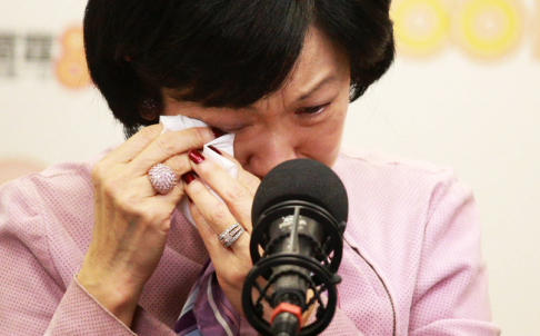 Regina Ip cries during an interview on Commercial Radio. Photo: SCMP Pictures