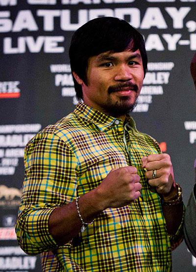 Pacquiao là võ sĩ quyền Anh chuyên nghiệp thành công nhất châu Á Ảnh: REUTERS