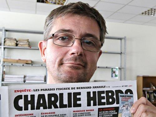 Stephane Charbonnier in đậm dấu ấn bằng các tác phẩm biếm họa trên tạp chí Charlie Hebdo. Ảnh: AP