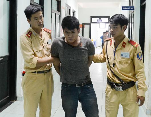 Nguyễn Trọng Huy bị dẫn giải về cơ quan công an
